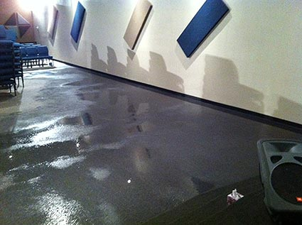 A burst water pipe causes extensive carpet water damage to a church in Saginaw, TX.